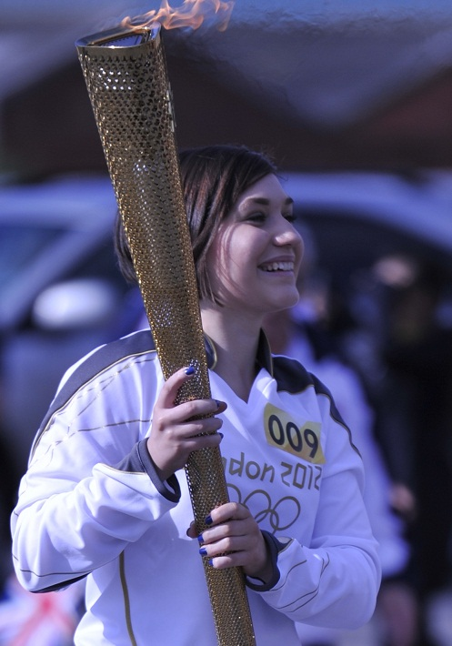 Sophie Chatel carrying the Olympic Torch